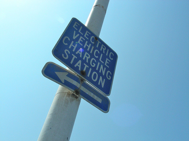 A sign pointing the direction to an Electric Car